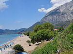 JustGreece.com beach Kampos (Votsalakia) with daarachter the Kerkis-gebergte - Island of Samos - Foto van JustGreece.com