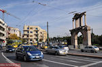 JustGreece.com The Arch of Hadrian on the busy Leoforos Amalias. (Attica) - Foto van JustGreece.com