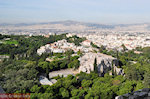 The Areopagus hill rots and daarachter the hill der Nymphen and Pnyx Athens - Photo JustGreece.com