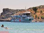 Boat in bay of Lindos - Photo JustGreece.com